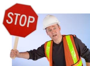 Vorfahrt gewähren bei einem Stoppschild